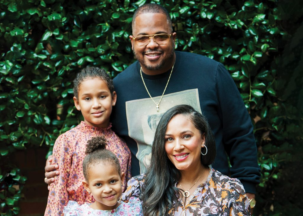 Songwriter Tricky Stewart with his family at home in Atlanta.